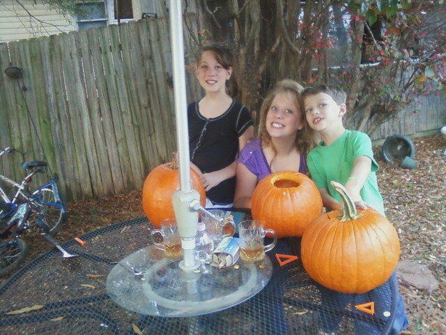 three kids and pumpkins